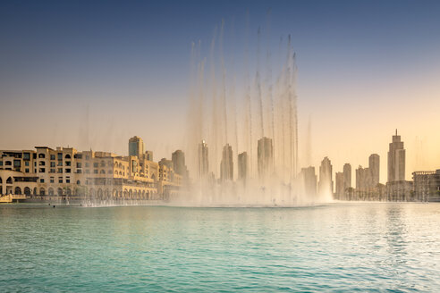 United Arab Emirates, Dubai, Fountain in the Burj Khalifa Lake with Souk Al Bahar - NKF000281