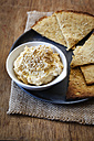 Bowl of Hummus and flat bread on jute - EVGF002177