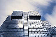 UK, London, glass facade of an office building in the financial district - ZM000397