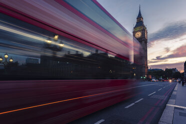 UK, London, red bus passing Westminster Bridge with Big Ben tower in the background at sunset - ZMF000401