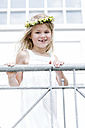 Portrait of smiling girl with tooth gap wearing floral wreath - GDF000773