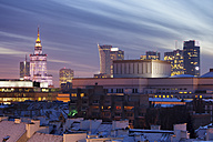 Poland, Warsaw, view to skyline of city centre at evening twilight - ABOF000027