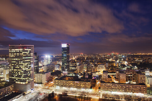 Poland, Warsaw, view to the city centre at evening twilight - ABOF000033
