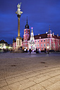 Poland, Warsaw, view to Castle Square with Sigismund's Column and lighted Christmas tree by night - ABOF000036