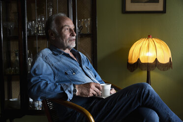 Senior man relaxing with cup of coffee at home - MEMF000845