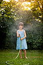 Little girl with garden hose - LVF003680
