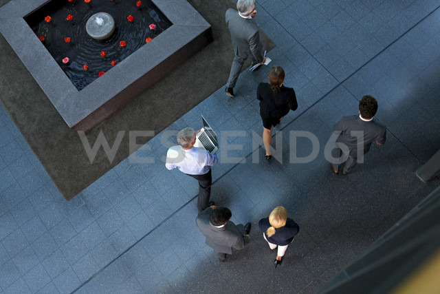Top view of businesspeople walking through lobby - CHAF000370