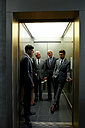Group of businesspeople in an elevator - CHAF000387