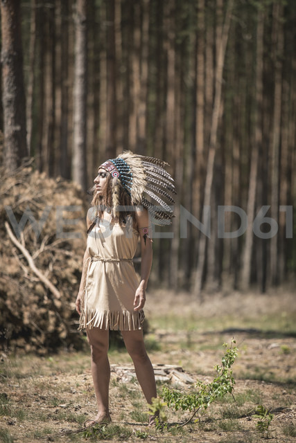 Young woman masquerade as an Indian standing in the woods - ASCF000211 - Anke Scheibe/Westend61