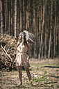 Young woman masquerade as an Indian standing in the woods - ASCF000211