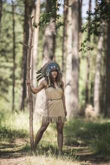 Young woman masquerade as an Indian standing in the woods - ASCF000214