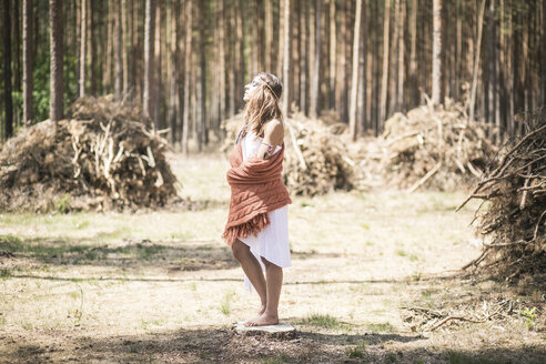 Young woman standing in the woods enjoying tranquility - ASCF000218