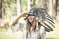 Portrait of smiling young woman masquerade as an Indian - ASCF000223