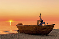 Germany, Ruegen, Binz, boat on beach at sunrise - PUF000384