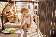 Mother and son together on balcony - MFF001817