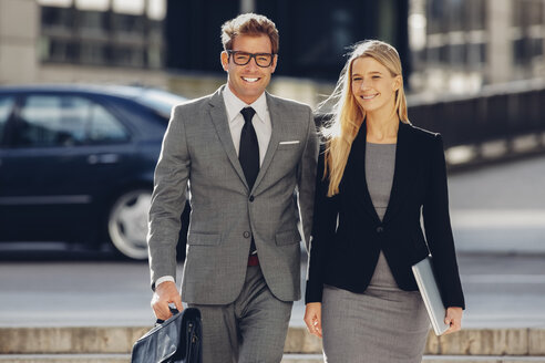 Smiling businessman and businesswoman outdoors - CHAF000423
