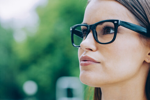 Young woman with glasses outdoors - CHAF000463