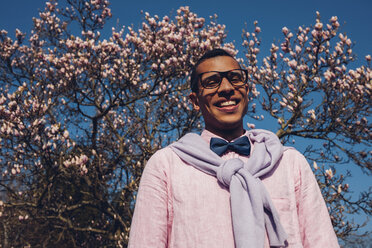 Young man in park in spring, wearing bow tie - CHAF001307