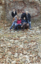 Group picture of six friends surrounded by broken bricks - HCF000129