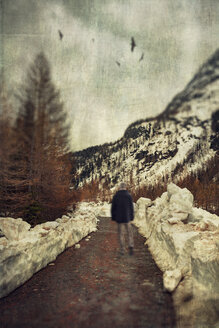 Italy, Lombardy, hiker on path in winter, digitally manipulated - DWIF000528