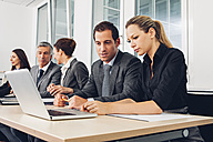 Business people in office working at laptop - CHAF001314