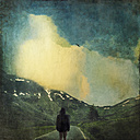 Italy, Man standing on mountain pass, Passo dello Spluga, textured effect - DWIF000537