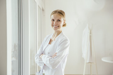 Portrait of smiling female doctor with arms folded - MFF001820