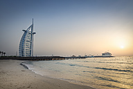United Arab Emirates, Dubai, Sunset at Jumeirah Beach with Burj al Arab and Jumeirah Beach Hotel - NKF000288