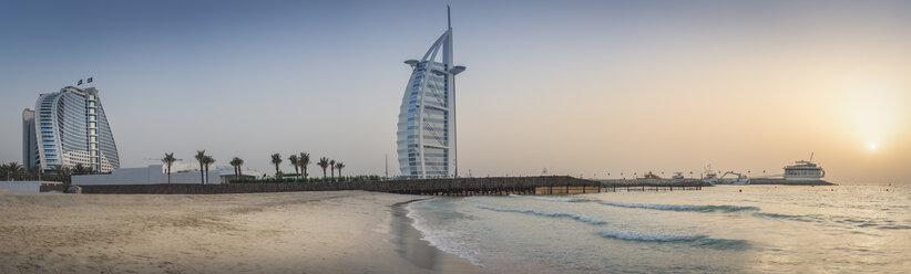United Arab Emirates, Dubai, Sunset at Jumeirah Beach with Burj al Arab and Jumeirah Beach Hotel - NKF000285