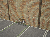 Racing cycle on parking lot leaning at brick wall, 3D Rendering - UWF000557
