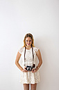 Smiling young woman with old camera - CHAF000595