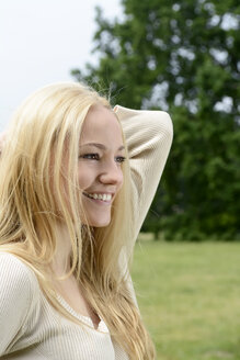 Portrait of smiling blond woman - BFRF001353