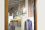 Germany, Berlin, Interior on men's tailor shop, facric samples and shirt in mirror - FKF001353