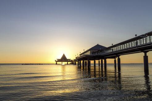 Germany, Usedom, Heringsdorf, sunrise at pier - PUF000375