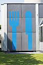 Germany, Bavaria, Munich, large fork and knife symbols on wall - VI000354