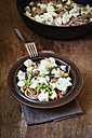 Dish of whole grain spelt spaghetti with roasted cauliflowers, hazelnuts, peas and basil - EVGF002095