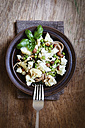 Dish of whole grain spelt spaghetti with roasted cauliflowers, hazelnuts, peas and basil - EVGF002096