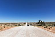 Namibia, Kalahari, off-road vehicle driving on gravel road - FOF008191