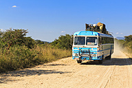 Zimbabwe, driving coach on a dirt road - FO008241