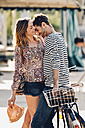Young lovers with bicycle on the street - CHAF000826