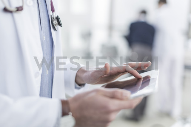 Close-up of doctor using a digital tablet - ZEF006747