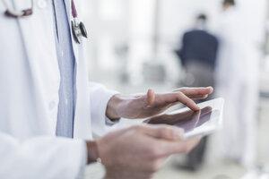 Close-up of doctor using a digital tablet - ZEF006747