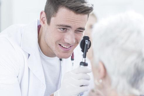 Doctor examining senior patient - ZEF005993