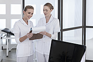 Two nurses looking at clipboard - ZEF006038