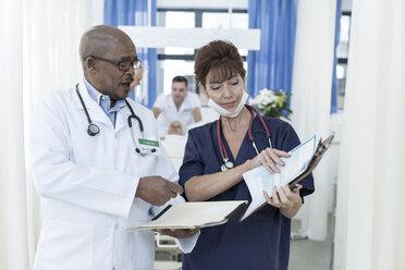 Two doctors in hospital talking - ZEF006228