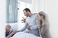 Couple visiting senior patient in hospital - ZEF006763