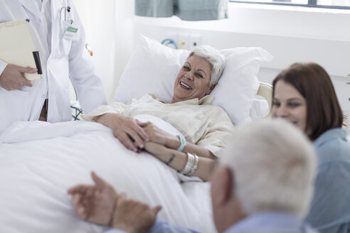 Family and doctor visiting patient in hospital - ZEF006768