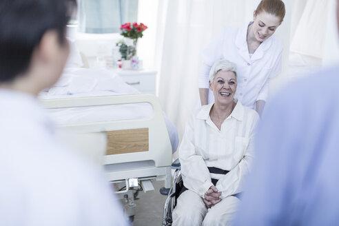 Nurse with elderly female patient in wheelchair - ZEF006808