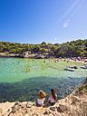Spain, Balearic Islands, Mallorca, Two female tourists looking to bay of Portals Vells - AM004104