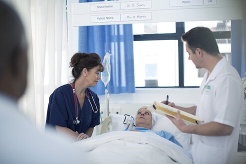 Dpctor and nurse with patient in hospital bed - ZEF006843